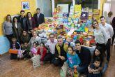 Montaña de alimentos e ilusión para el grupo 'La Esperanza'