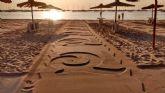 Premio nacional para la 'Q' en la arena de la playa