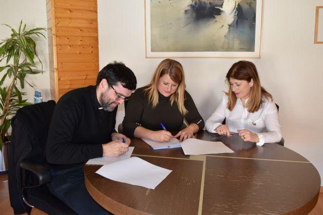 Convenio con Cáritas Puerto para prestar ayuda social, Foto 1