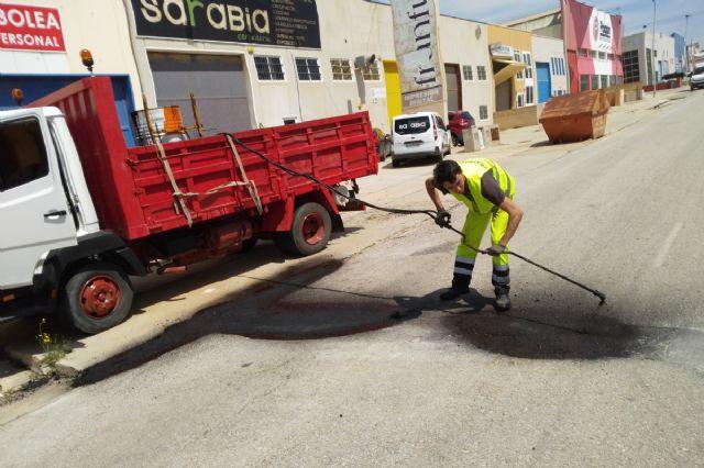 Infraestructuras repara desperfectos en el firme de varias calles del centro y barrios de Cartagena - 1, Foto 1