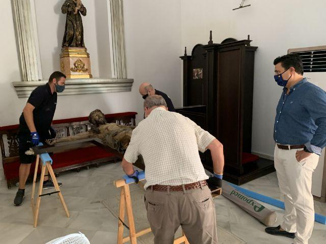 El Cristo de las Ánimas abandona el templo de San Javier para ser restaurado en el Centro de Restauración de la Región de Murcia - 4, Foto 4
