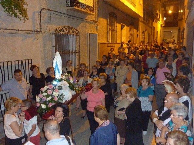 La delegación de Lourdes de Totana celebra el Santo Rosario por las calles de Totana, Foto 1