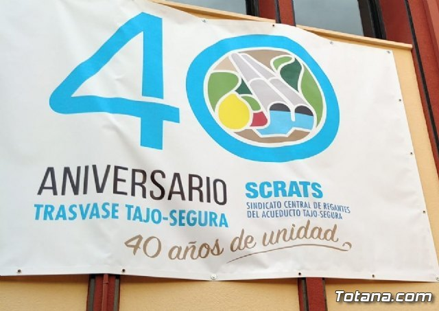 They place a banner of the 40th Anniversary of the Tajo-Segura Transfer on the facade of the Community of Irrigators of Totana - 2