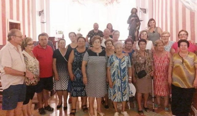 Neighbors and friends in the neighborhood of San Roque joins in living to celebrate the day of its patron