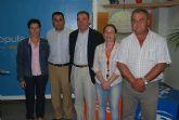 El senador Peñarrubia y la diputada del PP de Murcia, Cati Lorenzo, aseguran que hay que votar al PP para evitar más paro y el bloqueo de los trasvases