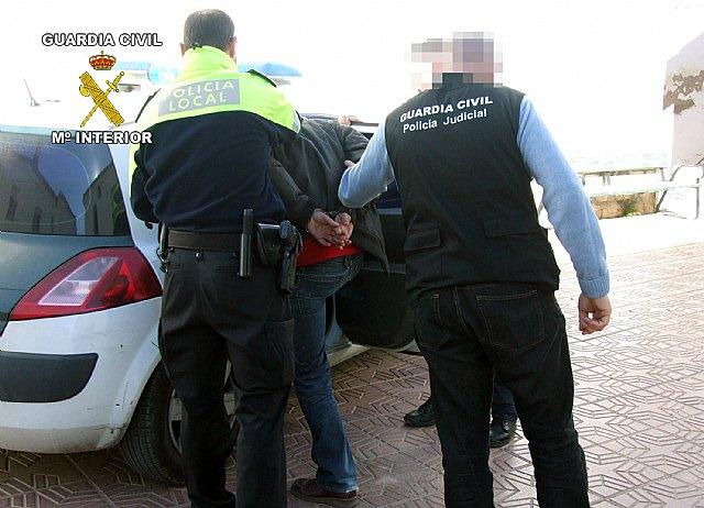 Desarticulada una banda dedicada al robo en comercios, Foto 1