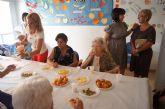 Los usuarios del Centro de Día del Servicio de Estancias Diurnas de Alzheimer celebran un almuerzo totanero