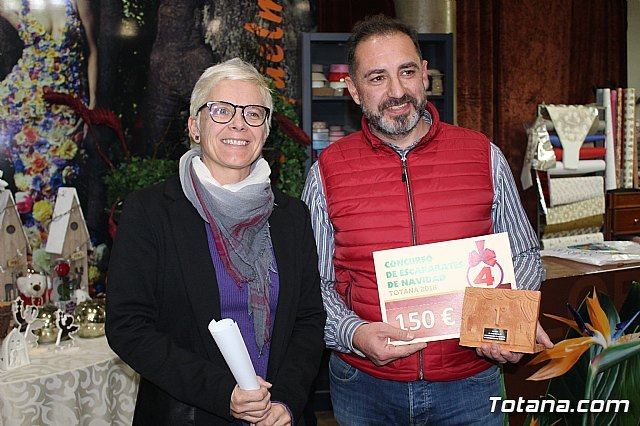 The prizes of the IV Christmas Window Dressing Contest are awarded