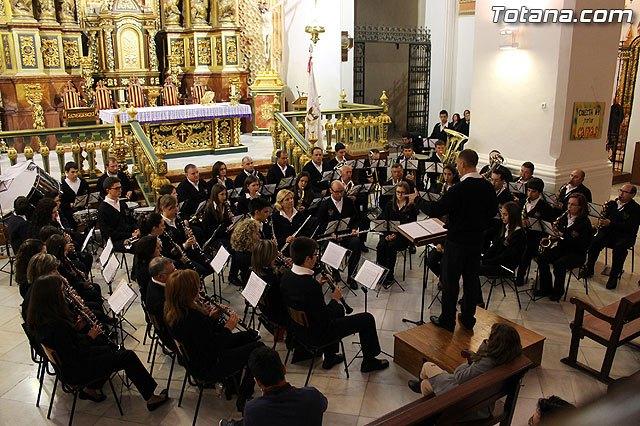 La Banda de Música de la Hermandad de San Juan Evangelista ofrece un concierto en la Parroquia de Santiago, Foto 1