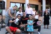 La Tribu gana el concurso de la tradicional cucaña