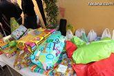 El II desayuno solidario a beneficio de C�ritas recaud� unos 200 Kg de comida y m�s de 100 juguetes - 2