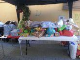 El II desayuno solidario a beneficio de C�ritas recaud� unos 200 Kg de comida y m�s de 100 juguetes - 14