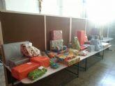 El II desayuno solidario a beneficio de C�ritas recaud� unos 200 Kg de comida y m�s de 100 juguetes - 15