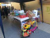 El II desayuno solidario a beneficio de C�ritas recaud� unos 200 Kg de comida y m�s de 100 juguetes - 16
