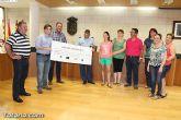 El EVA-13 entrega a D´genes y AELIP 2.558 euros recaudados en la carrera Dragon Challenge - 11