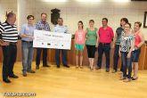 El EVA-13 entrega a D´genes y AELIP 2.558 euros recaudados en la carrera Dragon Challenge - 16