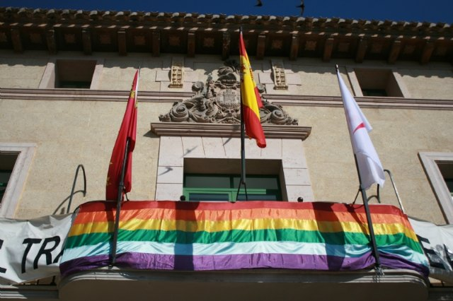 "The ""Arcoiris"" flag is placed on the balcony of the Totana City Hall to stage the institutional support for the LGTBI Collective"