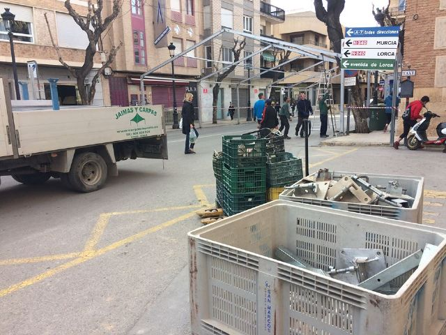 From today and until December 10, Calle Sol is cut off for traffic by the installation of the Carp of the Day Fair, Foto 6