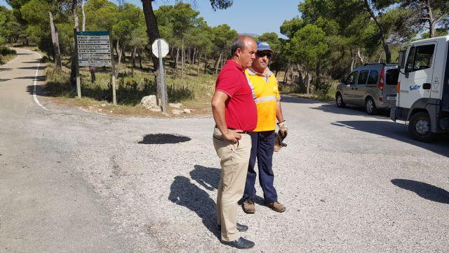 Arreglo urgente de baches en la carretera de las Cuestas del Marqués, Foto 1