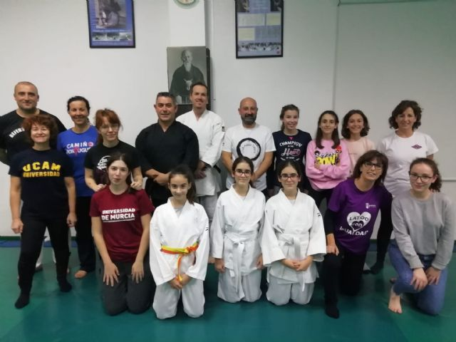 A group of women participate in the first session of the Master Class of Women's Self Defense