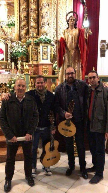 La Hdad. de San Juan Evangelista celebró el pasado miércoles una Eucaristía coincidiendo con el día de su onomástica en la Parroquia de Santiago el Mayor, Foto 3