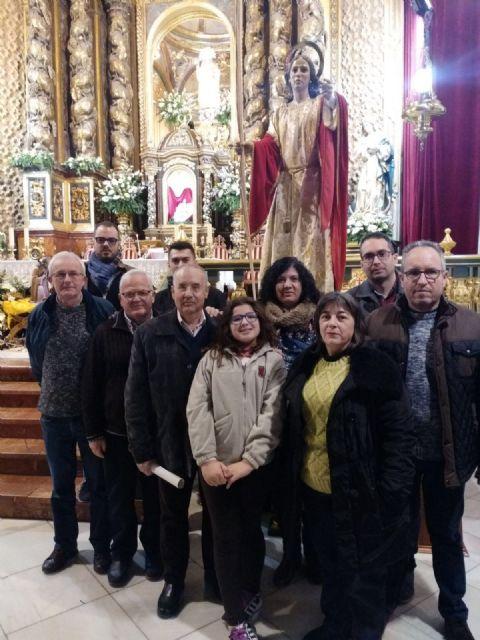 La Hdad. de San Juan Evangelista celebró el pasado miércoles una Eucaristía coincidiendo con el día de su onomástica en la Parroquia de Santiago el Mayor, Foto 4