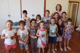 """Cerca de una veintena de niños y niñas participan en el Taller de Cocina Creativa y Divertida que se celebra en las cocinas del Centro Sociocultural """"La C�rcel"""""""