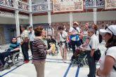 Los Centros de día para la Discapacidad de Totana realizan una visita guiada a la sede de la Asamblea Regional en Cartagena