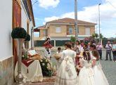 El 'Corpus Christi' recorre las calles lumbrerenses entre flores y nuevos comulgantes