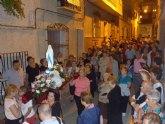 La delegación de Lourdes de Totana celebra el Santo Rosario por las calles de Totana