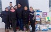 La Hdad. de Jes�s en el Calvario entrega a C�ritas de las Tres Avemar�as juguetes y donaciones
