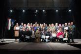 Homenaje al grupo de Coros y Danzas 'La Purísima' en las fiestas patronales