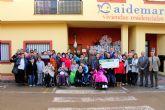 Caja Rural entrega a Aidemar lo recaudado en la bicicleta solidaria celebrada con motivo de la Vuelta Ciclista a España