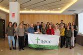 El grupo Patchwork y la Asociación de Vecinos Oasis, donan 950 euros a la AECC de Los Alcázares