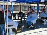 'Córtate por una buena causa'. Profesionales de la peluquería y el estilismo de media España participan en la III Jornada de Barberos Solidarios en Alcantarilla