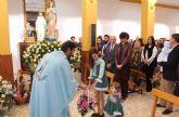 Los vecinos de La Estación-Esparragal homenajean a su patrona con la ofrenda floral