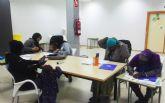 El barrio del Carmen sigue con sus actividades de español y alfabetización para inmigrantes, y de apoyo escolar