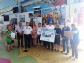 La ONCE presenta en la lonja de pescadores su cupón para promocionar el consumo de sardina