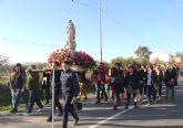 La Purísima recorre El Esparragal en romería acompañada por la Cuadrilla y cientos de vecinos