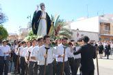 Los niños del San Pedro Apóstol inician la Semana Santa con el traslado de San Juan Evangelista