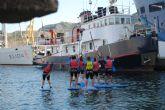 Imparten clases de paddel surf en el puerto para la comunidad universitaria