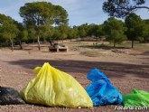 Escolares recogen basura en el paraje de La Santa