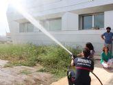 Los usuarios del Centro de Día para personas con discapacidad son evacuados en un simulacro de incendio