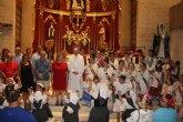 Vecinos de Lo Pagán honran a la Virgen del Carmen con la tradicional ofrenda de flores