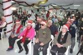 Usuarios y trabajadores del Centro de Día de Personas Mayores de la plaza Balsa Vieja celebran la Fiesta de la Navidad 2019