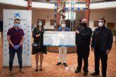C�ritas Mazarr�n recibe 4.500 euros de La Caixa