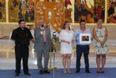 Arturo Ponce recibe el premio de fotografía de la Semana Santa pinatarense
