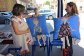 La asociación Patchwork Mar Menor muestra sus trabajos en la calle