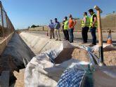 El director general de Carreteras y el alcalde visitan las obras de reparación de carreteras regionales dañadas por la dana en el municipio