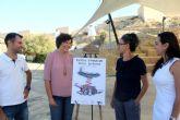 Un cartel de la artista local Adela García Olivares anuncia las fiestas de Puerto Lumbreras